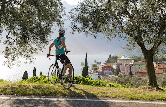 Female cyclist in Italian countryside