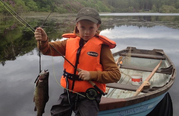 Child fishing on Killeen Lake, Ballynahinch Castle Hotel