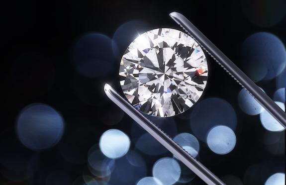 Tweezer holding diamond/thinkstock
