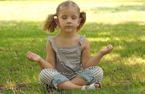Little girl meditating, Six Senses Porto Elounda Golf & Spa Resort